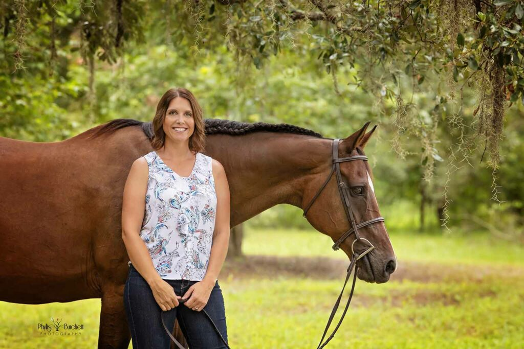 Cara Swift of Fast Horse Photography with her horse, Vera