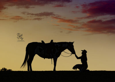 Cowgirl and western horse silhouette