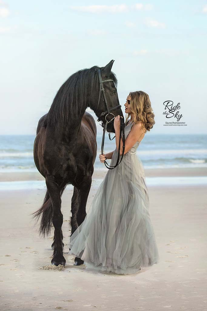Girl in Gown on Beach with Friesian Horse