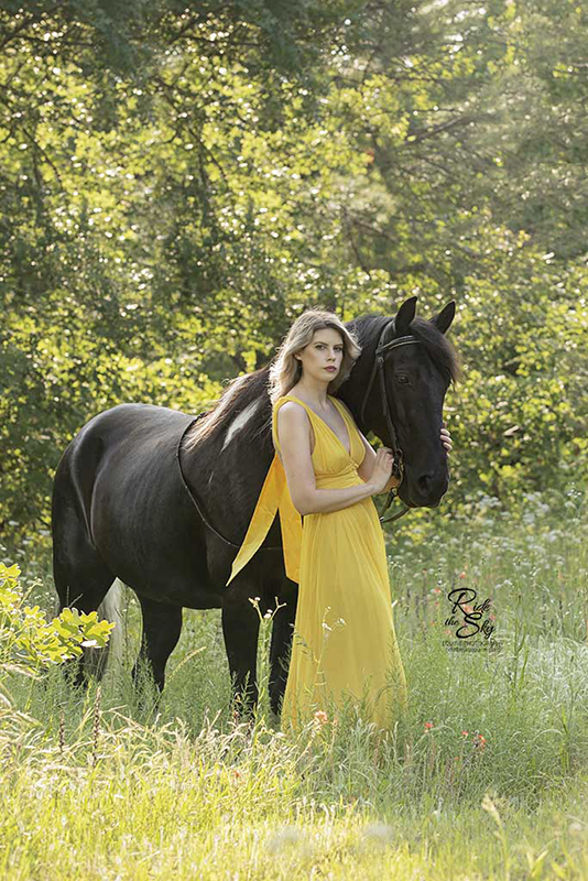Girl in Yellow dress with Tennessee Walking Horse in Field in Spring