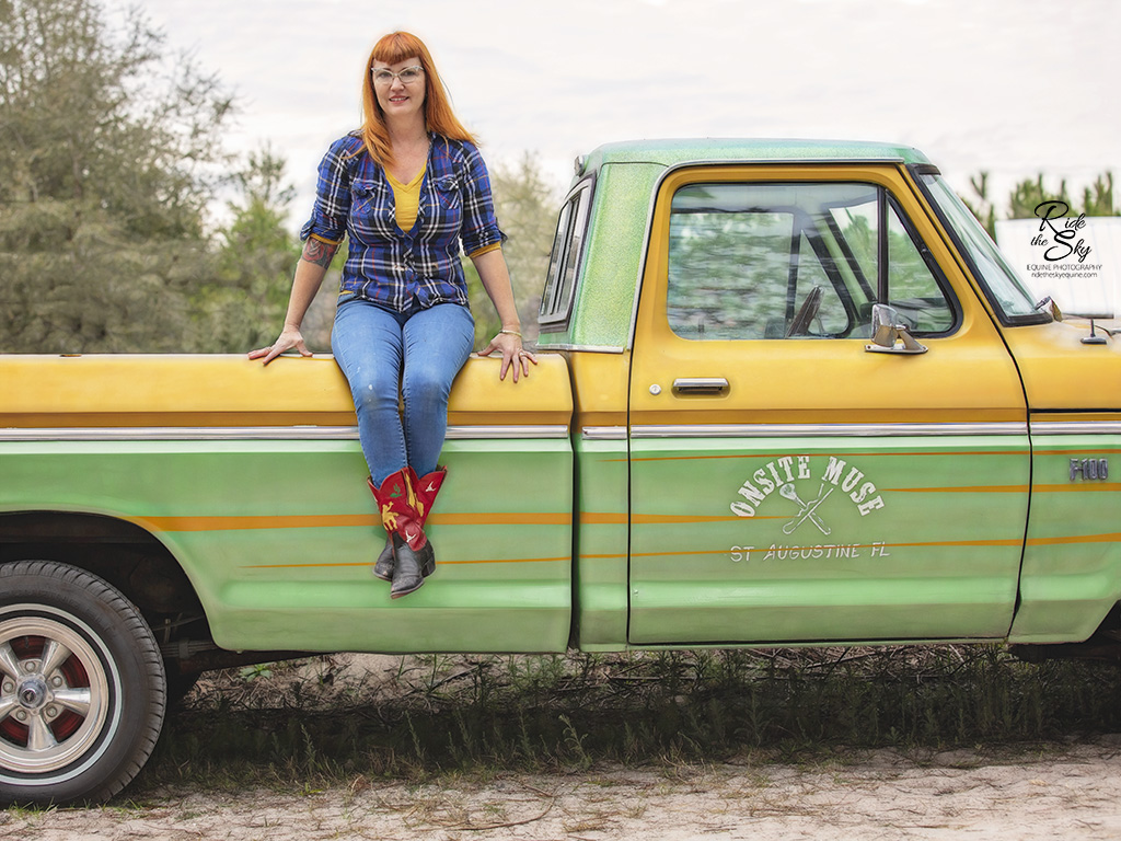 Kira McCarty of Onsite Muse Florida sitting on her truck