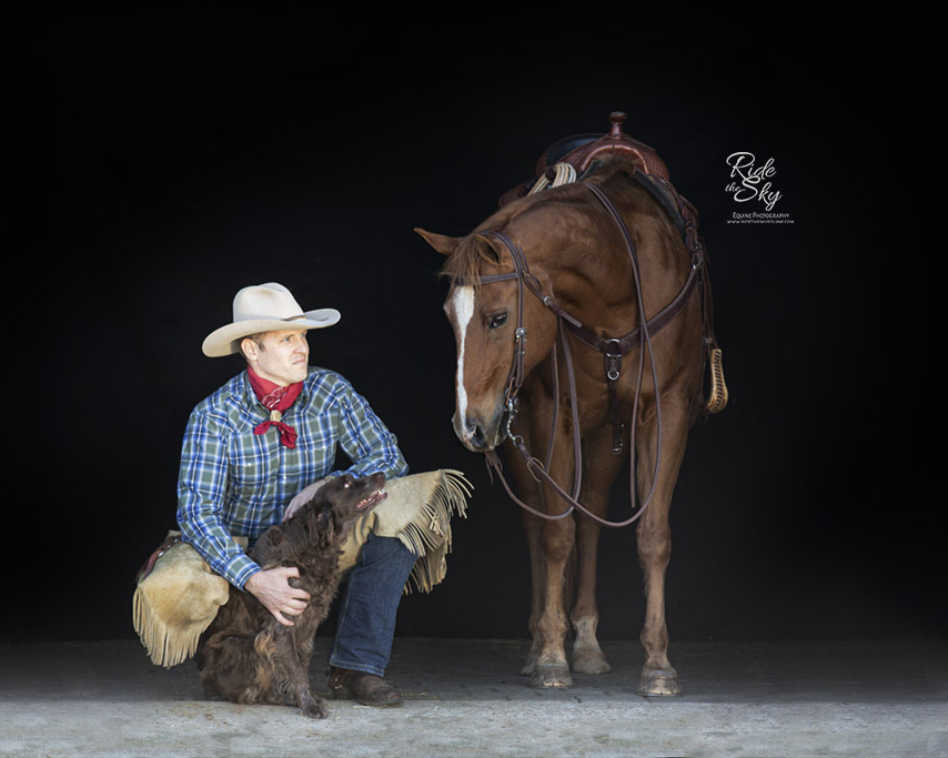 Portrait of Cowboy with his horse and dog
