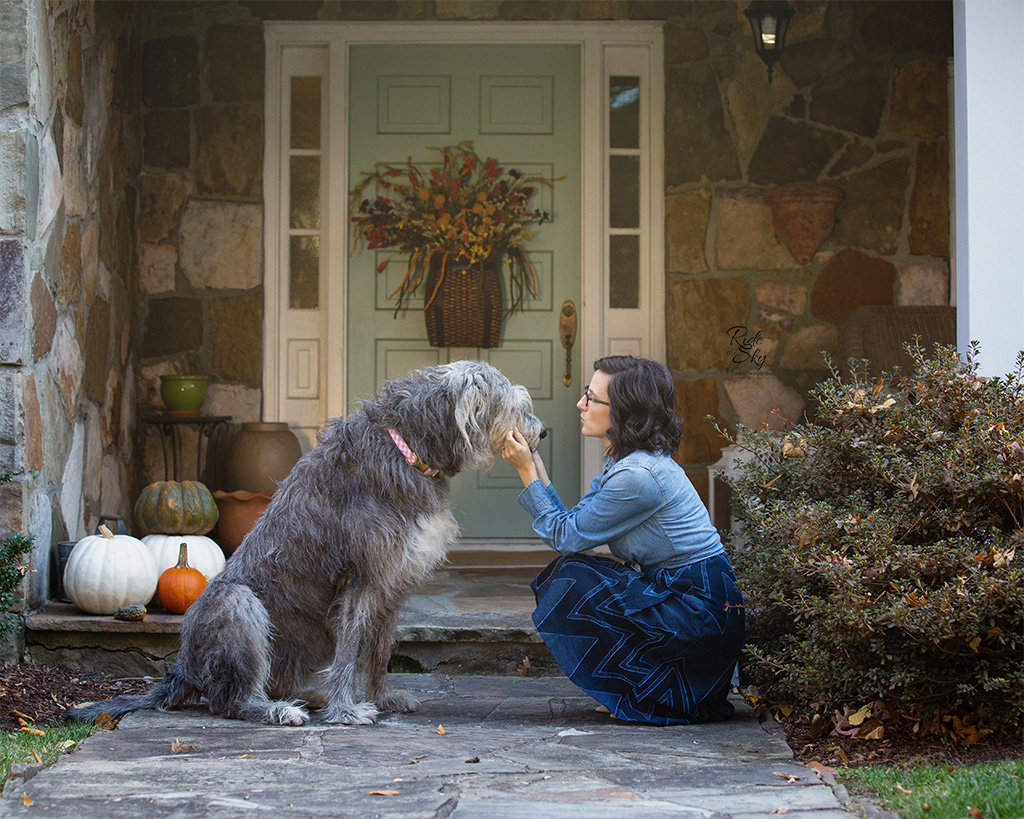 Woman and Terminally Ill Irish Wolfhound dog Portrait outside of house in Fall