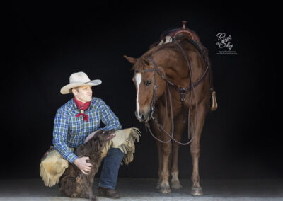 Black Background Portrait of Cowboy with Horse and Dog