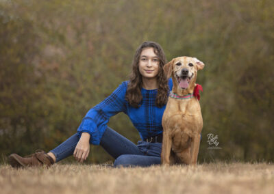 Teenage Girl with sassy Black Mouth Cur Dog in fall