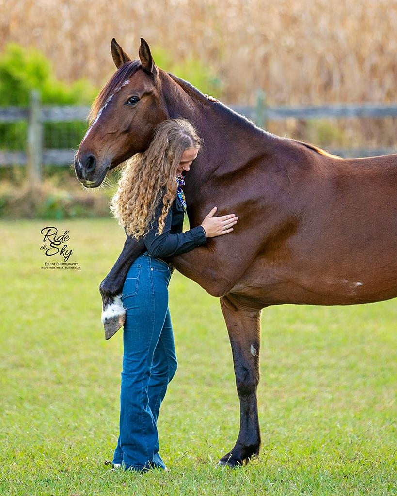 Mustang Horse Hugging Her Trainer AR Horsemanship