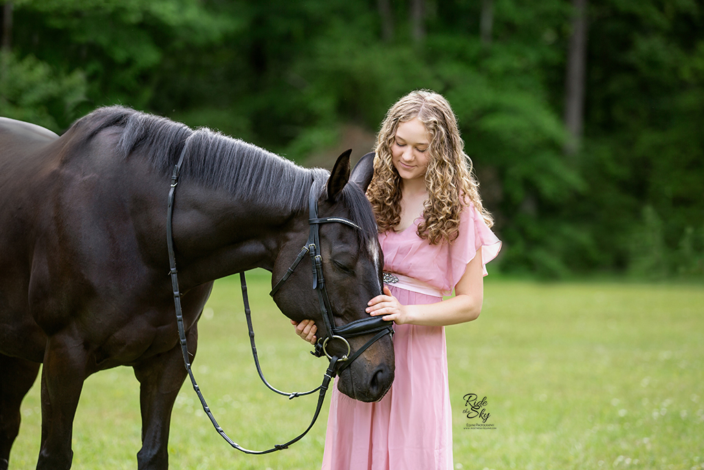 Girl and Thoroughbred horse in emotional moment