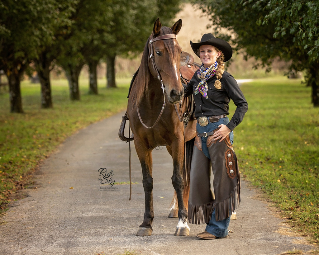 Mustang Horse Trainer Allyssa Rennebu with her liberty trick trained mustang Raven